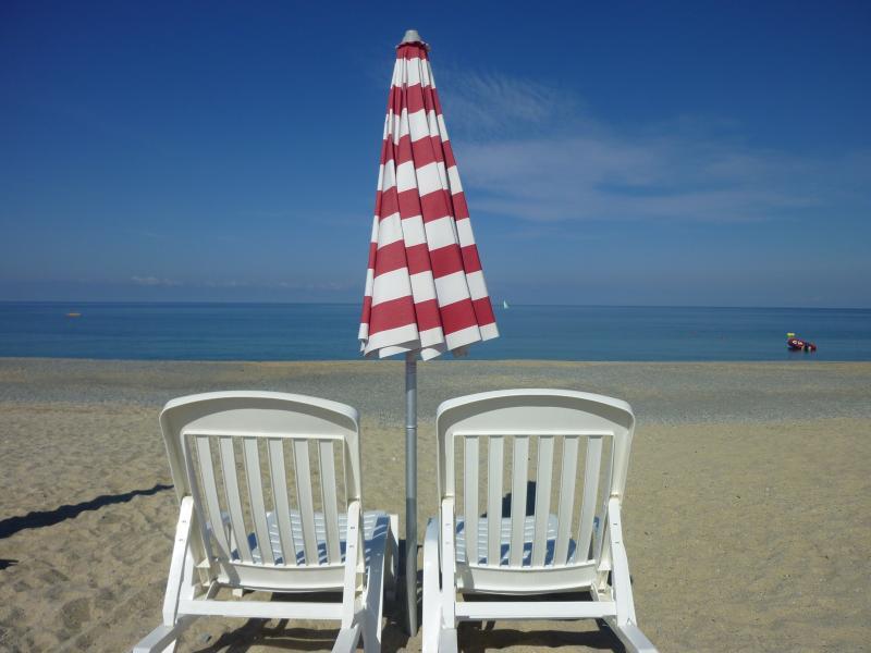Private beach at Pizzo Beach Club.