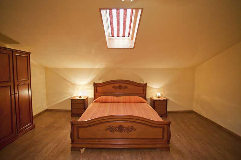 bedroom with air conditioner...