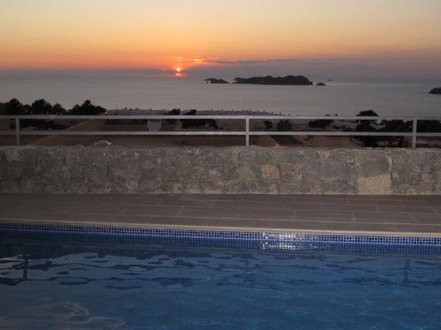 view from the pool of the sunset over the sea
