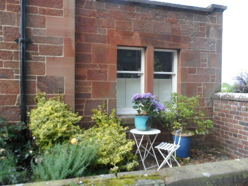 The property adjoins a family home but has its own entrance and garden area.