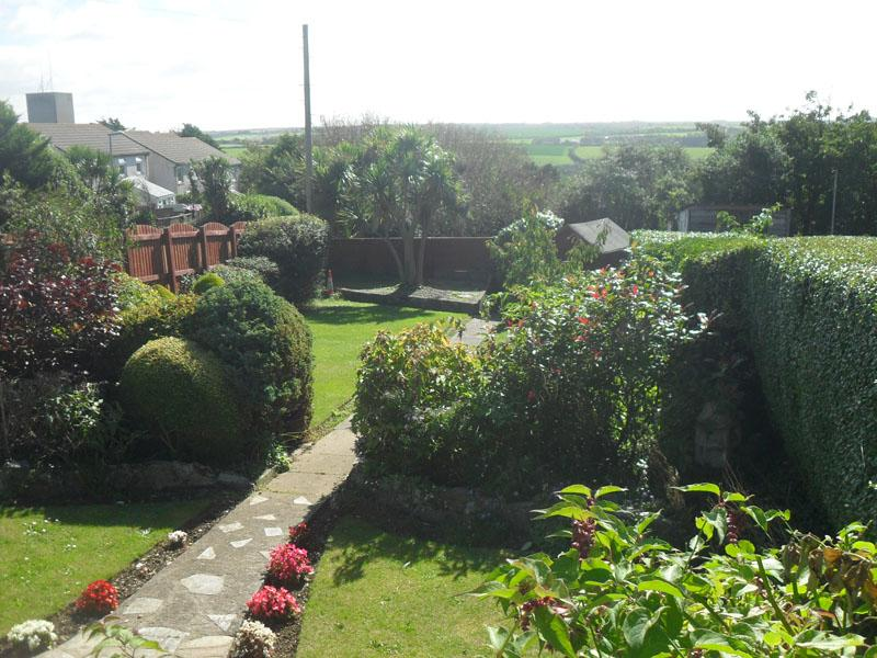 Private front south facing enclosed garden with country views.