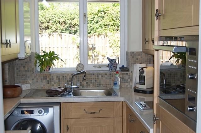 Kitchen with washer/dryer, hob, combination microwave