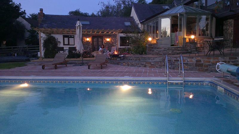 Pool & Barn at Night; why not enjoy a late night swim in your own, exclusive heated pool?