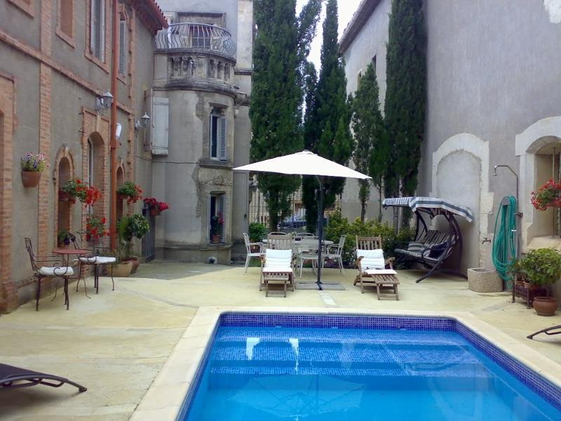 Chateau's sunny courtyard from deep-end of pool
