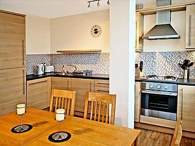 Dining with oak furnture providing seating for six guest and fully equiped kitchen