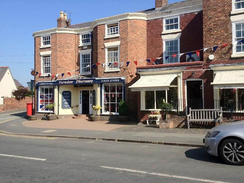 Farndon High Street: Pharmacy,Post Office, Newsagent, pubs, restaurant, Paul Burrell's flower shop.