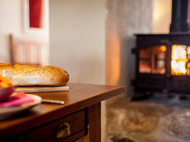 The feature wood burning stove brings a romantic feel to any evening
