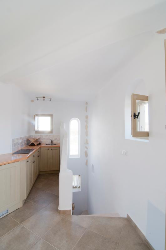 Galley kitchen with stairs leading to lower ground floor twin bedroom and 2nd bathroom