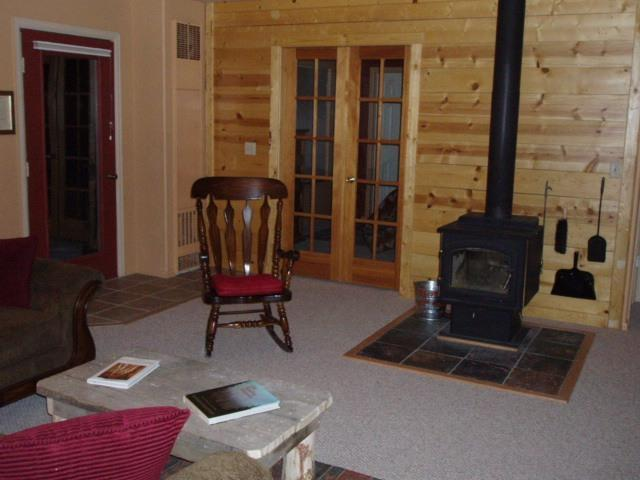 Cozy Colorado Great Room Glass Door Free Standing Fireplace for those cool Mountain Evenings