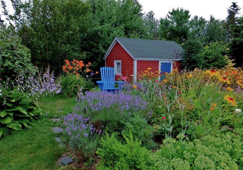 The July garden, adjacent to the house. Outbuilding in background.