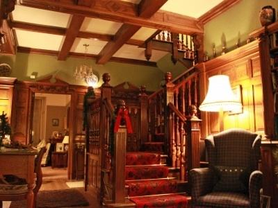 Wood panelled hallway, complete with gargoyles