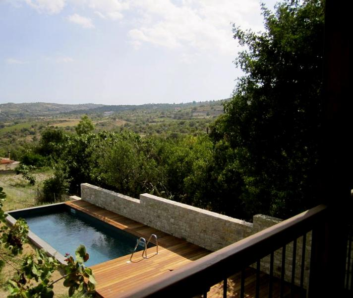 view of the private swimming pool from the upper floor balcony
