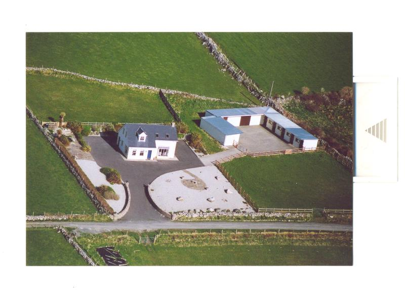 Ariel View including landscaped gardens, pond, back and front paddocks & stables