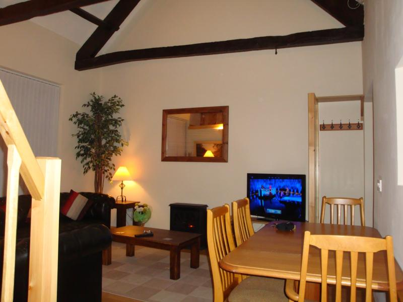 Living and dining area with flat screen TV