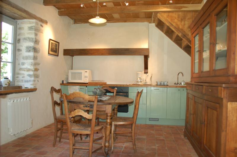 The Kitchen, old original hand-made floor tiles and new oak ceiling- all modern facilities included.