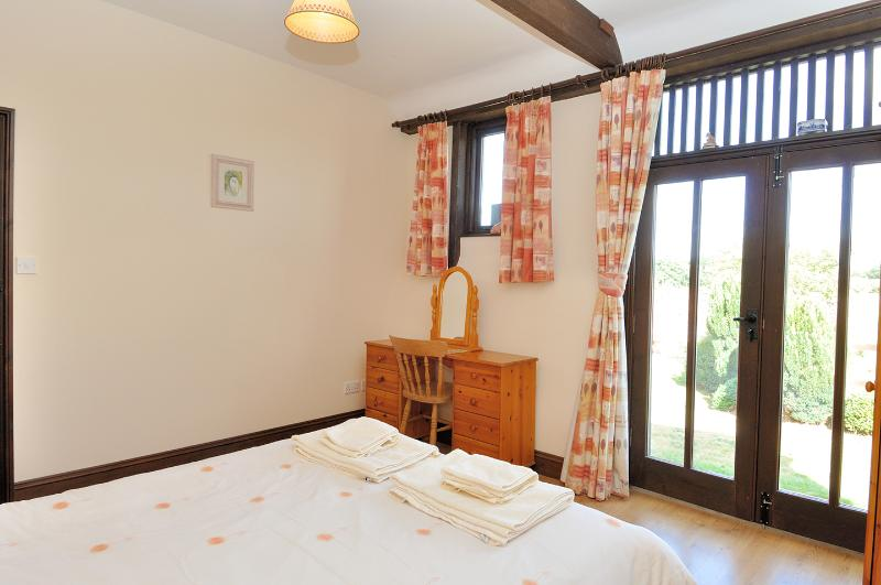 Enjoy the far reaching country views from your bed