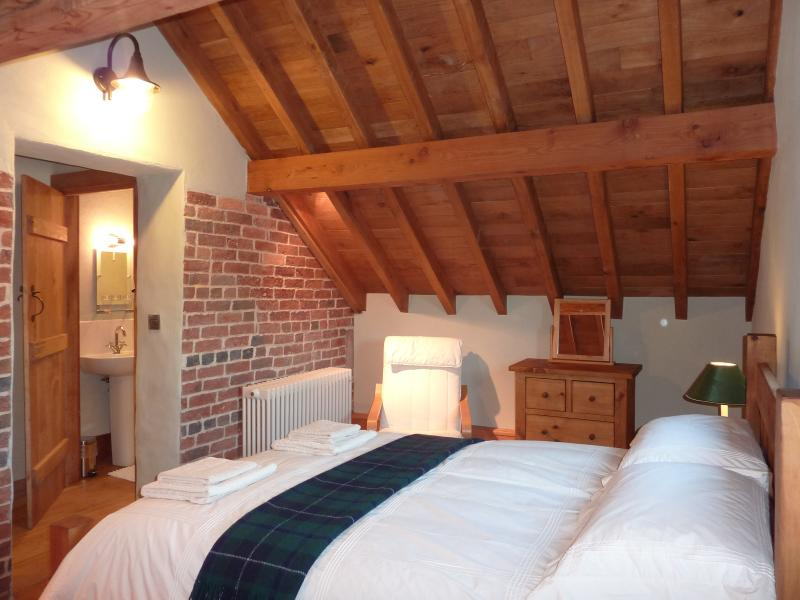Double Bedroom with ensuite shower room, quality oak flooring, exposed features of brick and beams