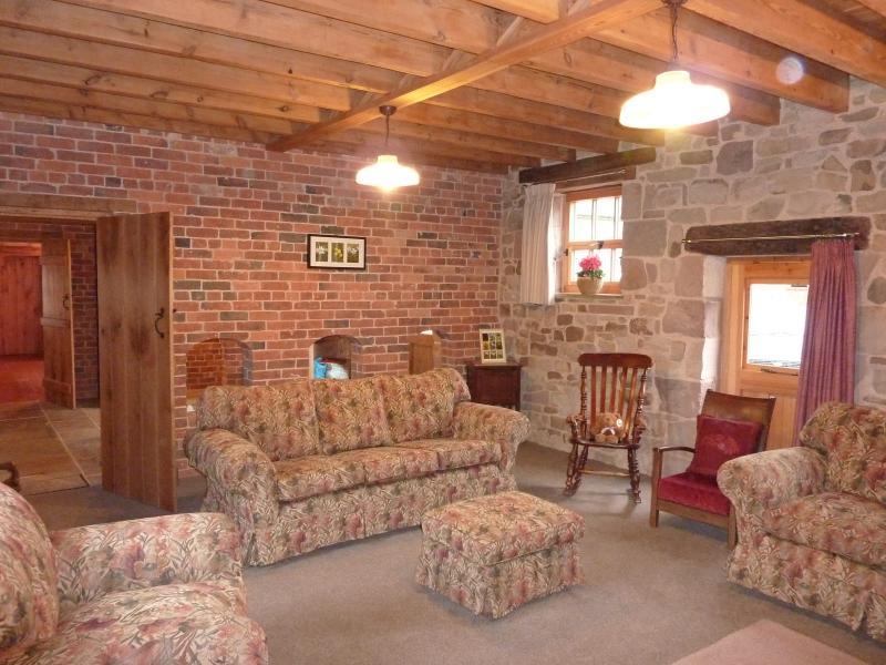 Lounge: Cosy with underfloor heating & log burning stove, beautiful exposed stone, brick & b