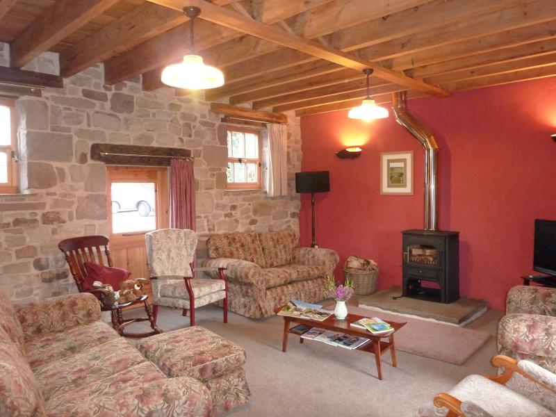 Lounge: Cosy cleaview log burning stove, Flat Screen TV, DVD player, CD/Radio