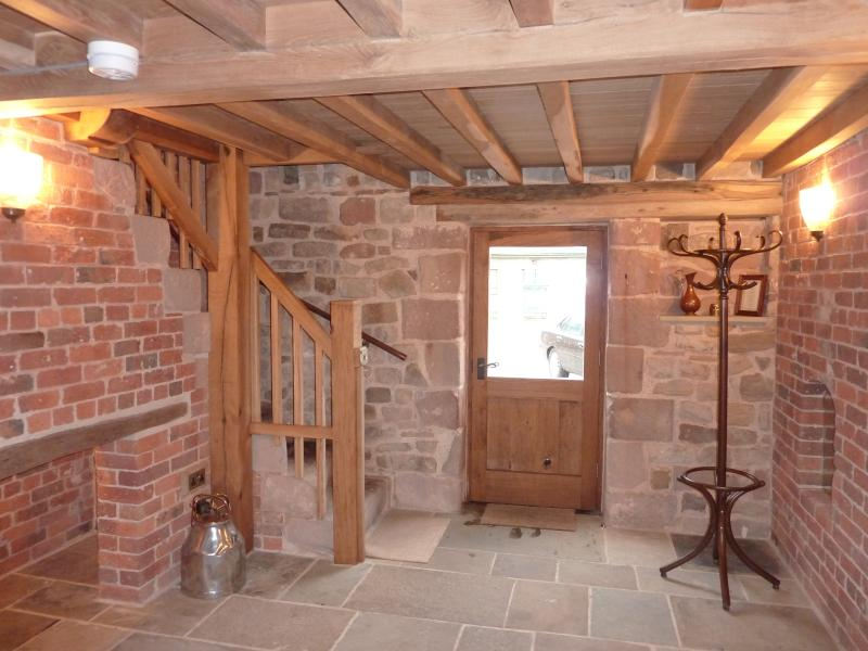 Spacious entrance hall with character beams & original stone granary steps to first floor bedroo