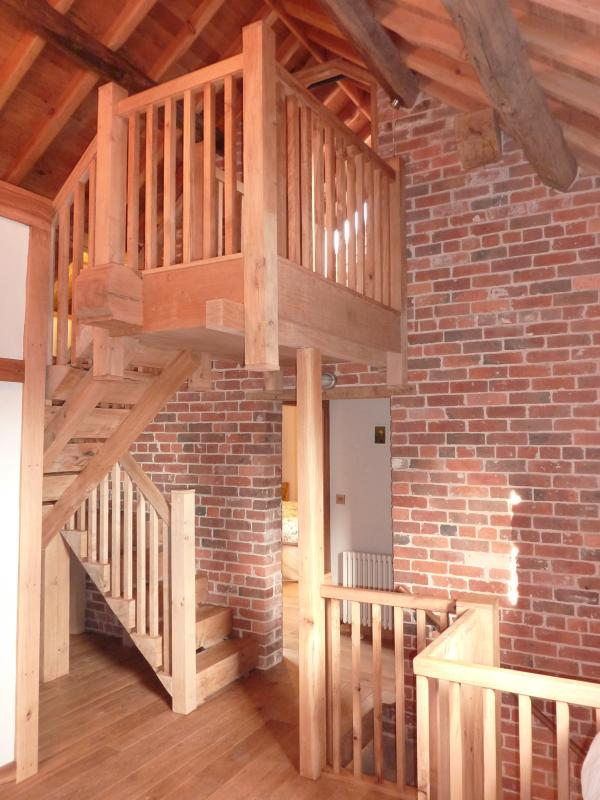 Landing area on 1st floor with beautiful oak staircase to 2nd floor - made from local oak tree