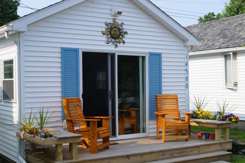 Relax on the front deck adirondack chairs facing the lake