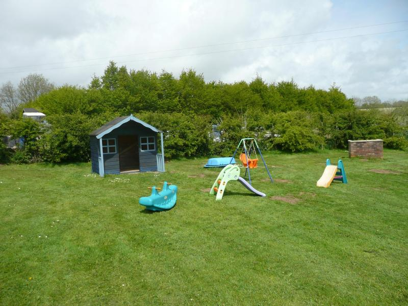 Our garden with play house and plenty of open spaces to play.