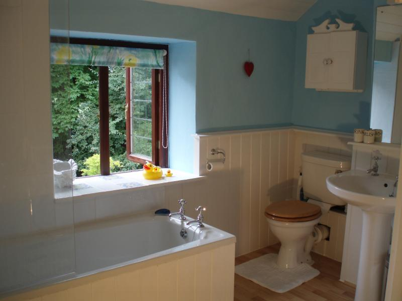 Family bathroom with bath and shower attached. Separate shower in en-suite.