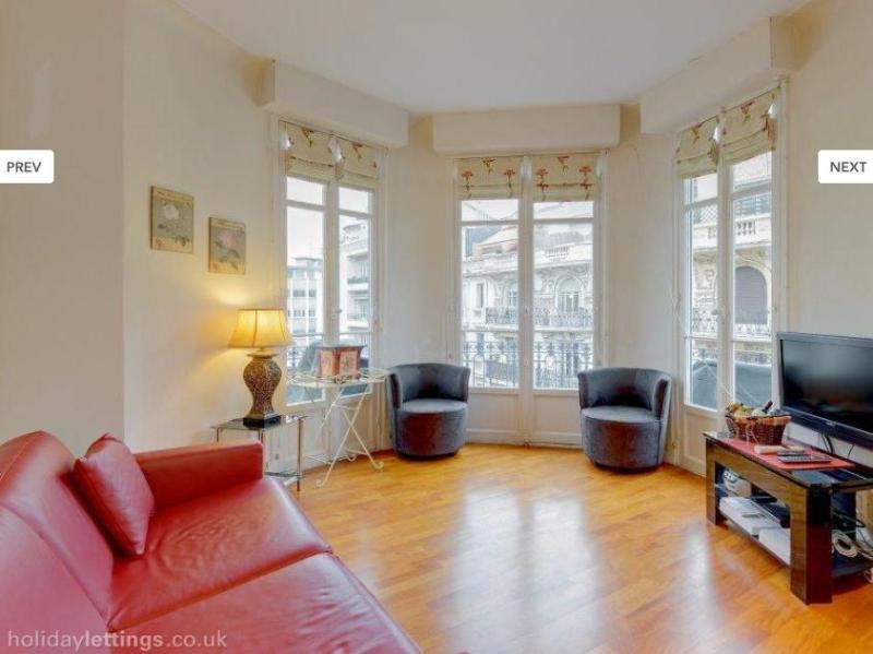 Bright, light and airy lounge space, with sweeping curved balcony and Juliet balcony kitchen area