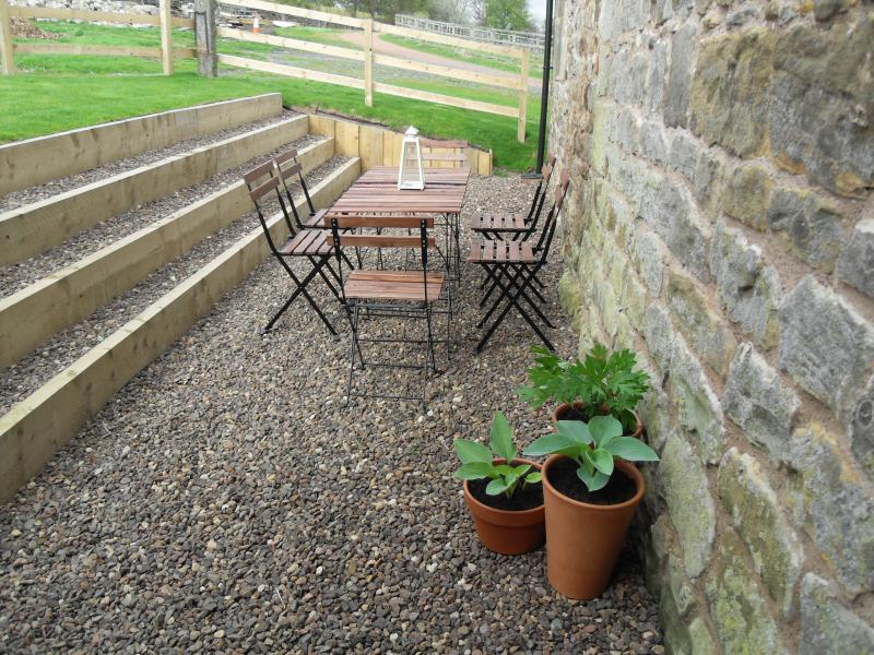 Front and rear gardens with patio furniture