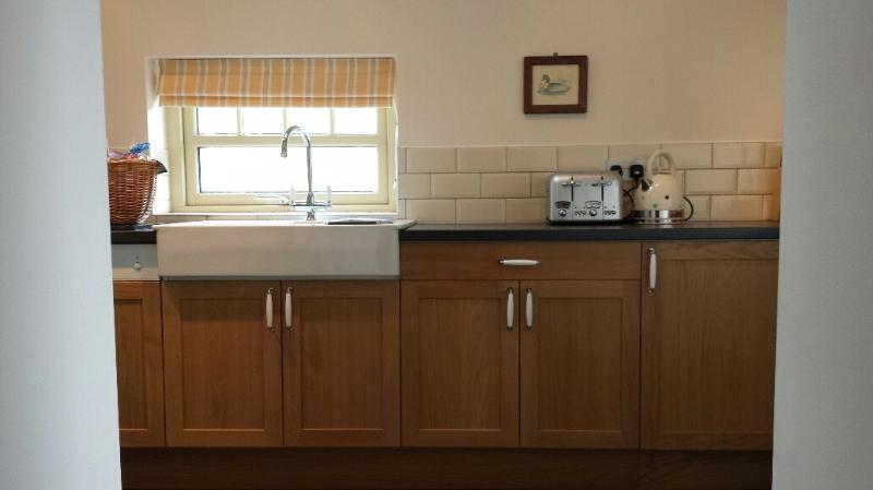 Kitchen with Dishwasher, Washer/Dryer, Microwave, Double Sink, Electric oven and Hob