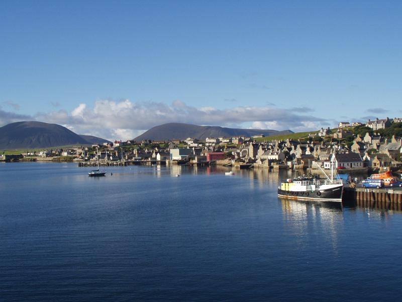 Stromness harbour is sheltered by the high hills of the neighbouring island of Hoy.