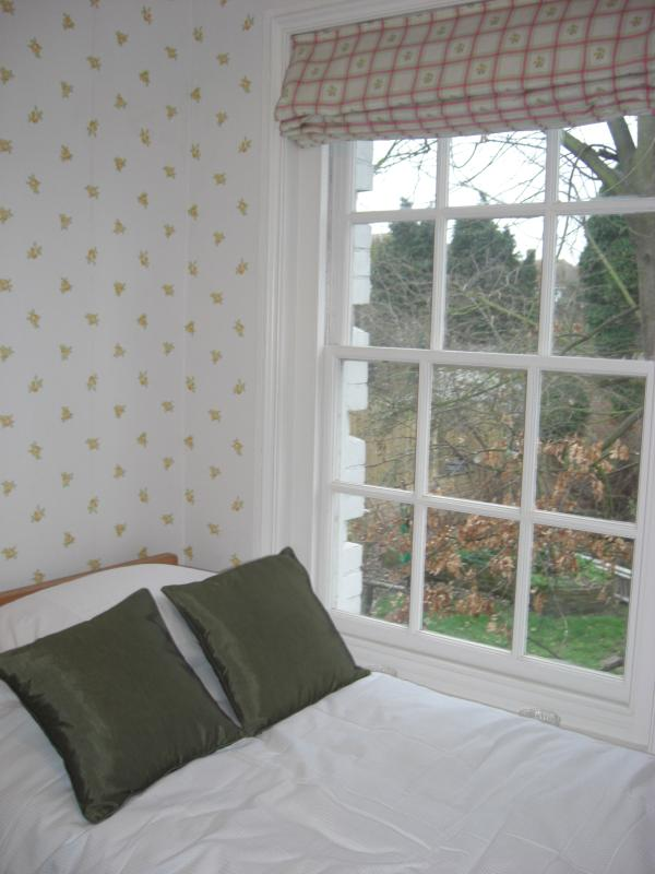 The Yellow Bedroom with view of garden
