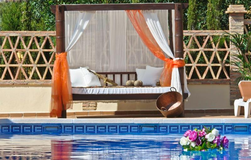 Enjoy the balinese beds surrounded by the sun and chill out music at the pool