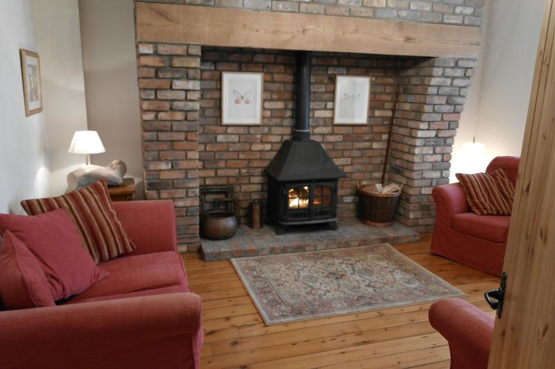 Our lounge has deep sofas, a wood-burning stove, free wifi and views of the leafy lane