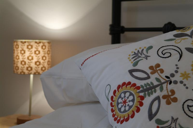 Crisp white sheets and snuggly duvets in our master bedroom, double and twin rooms
