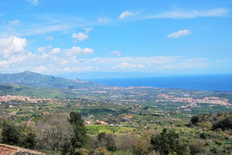 The panoramic view of Taormina, Castelmola and the Ionian coastline from the terrace.