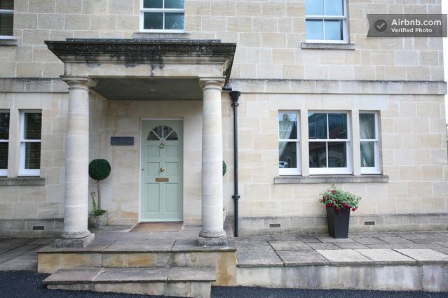Traditional stone pillars make a grand entrance, in the typical Bath style