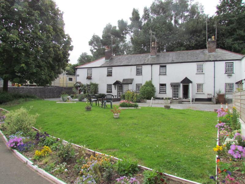 Devon Square Cottage is far left