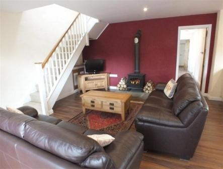 Cosy seating area with a log burner.