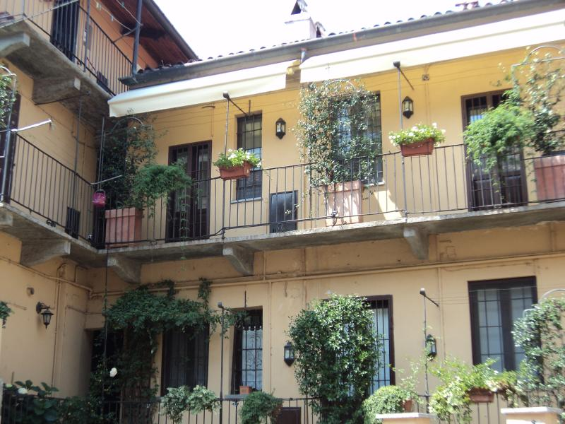 The beautiful flowered balconies of the two-floor apartment