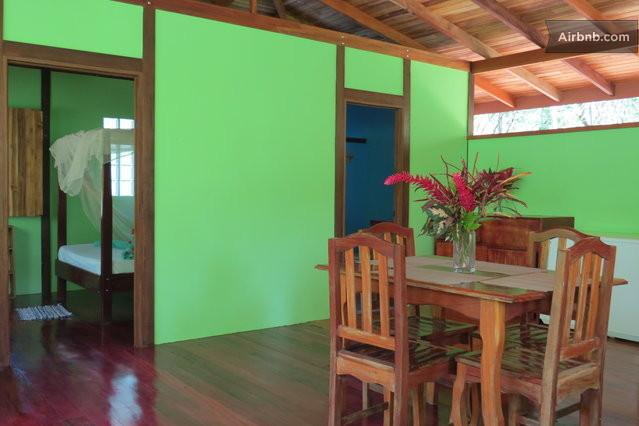 Inside Casa TiTi at Cabinas Ola Mar. Kitchen and dining room view, with a peek into the bedroom