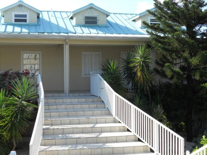 Easy access front steps, with reserved parking spot right in front. visitor spots across the street