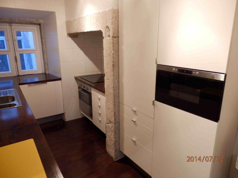 Kitchen view 2 with electric induction stove top, oven and microwave