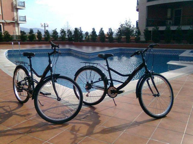 Outdoor pool and multi-purpose bicycles.