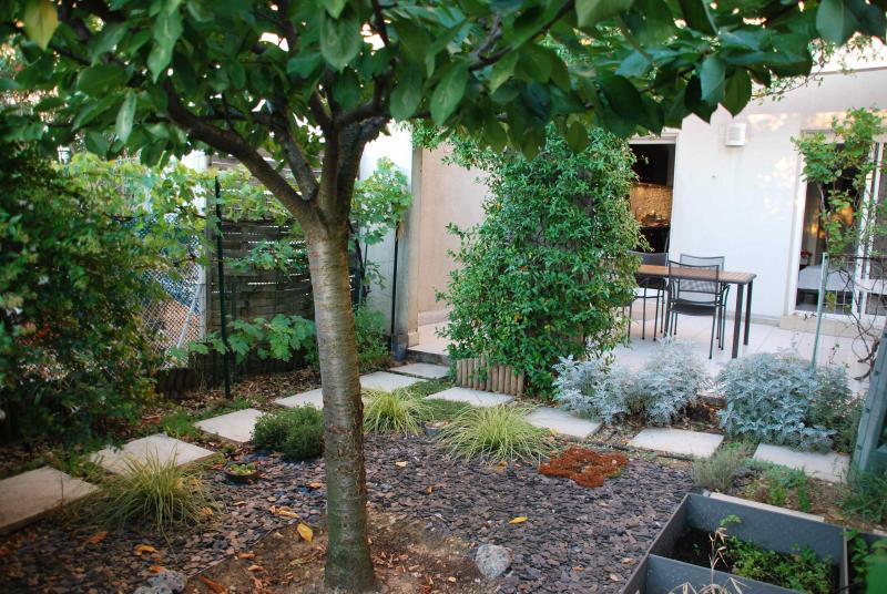 The back garden and the terrace leading to the kitchen and the bed room