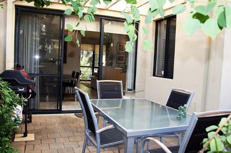Enjoy a bbq in your own private leafy courtyard setting
