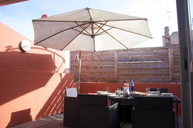 Sunny drenched roof top terrace.