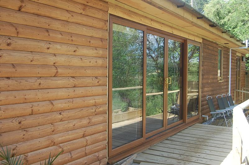 THE LODGE...a fully insulated three bed timber lodge with large panoramic windows.