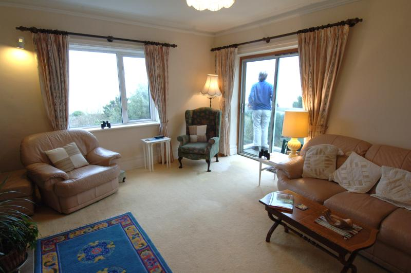 Sitting room with doors to balcony and Swanage Bay views